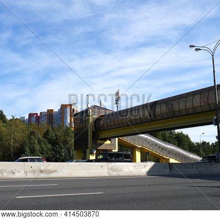 Pedestrian Crosswalk Raised Above The Expressway. A Building For A Safe Crossing Of The Highway