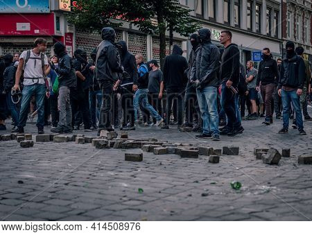 Sternschanze Hamburg, Germany - July 7, 2017: Protesters Loosen Stones To Throw On Police Forces Dur