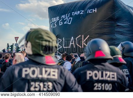 Hamburg, Germany - July 6, 2017: Policemen Waiting For Demonstration In Front Of Antifa Protest Blac