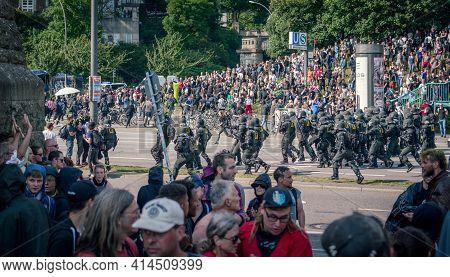 Landungsbruecken Hamburg, Germany - July 7, 2017: Riot Police Disperses Crowd During G20 Summit Demo