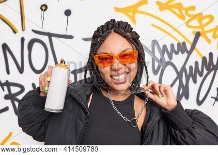 Trendy Fashionable Teenage Girl Dressed In Black Clothes Orange Sunglasses And Metal Chain Has Braid