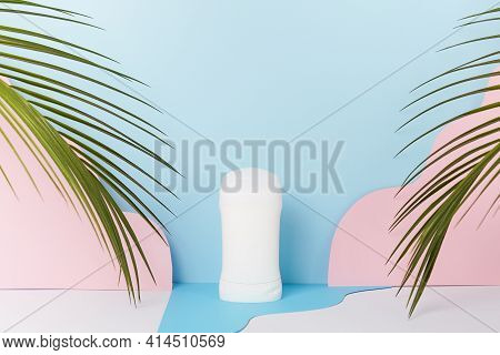 Mockup Cosmetic Deodorant, Bottle Packaging On A Blue Background With Palm Leaves, Body Skin Care. C