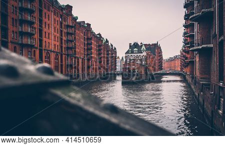 Speicherstadt (city Of Warehouse) With Steel Bridge And Canal In Cloudy Day, Hamburg