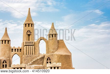 Sandcastle During A Sunny Day With Blue Sky Background. Concept For Summer, Vacation, Relax And Fun.