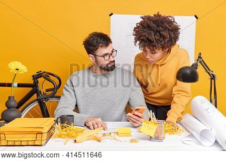 Mixed Race Woman And Man Coworkers Try To Find Solution Of Work Check Information In Internet Via Mo