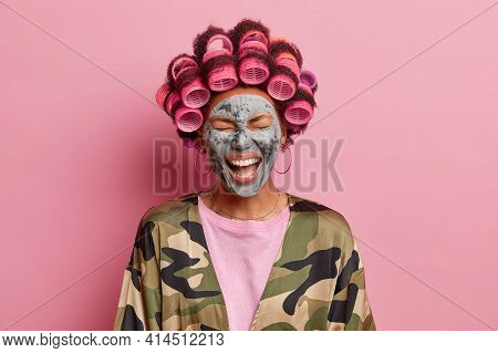 Photo Of Overjoyed Ethnic Woman Laughs Out Loudly Fels Very Happy Enjoys Facial Treatments Wants To