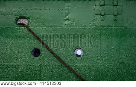 Old Round Porthole On Green Ship Deck With Ropes