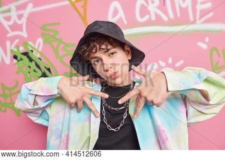 Yo Look At Me. Self Satisfied Cool Fourteen Years Old Guy Males Rap Gesture Wears Fashionable Clothe