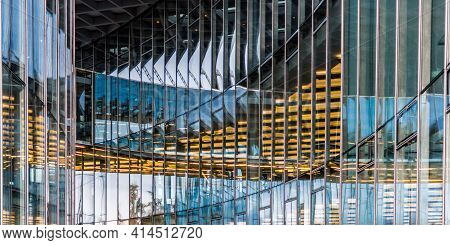Panoramic And Prospective Wide Angle View To Steel Light Blue Background Of Glass High Rise Building