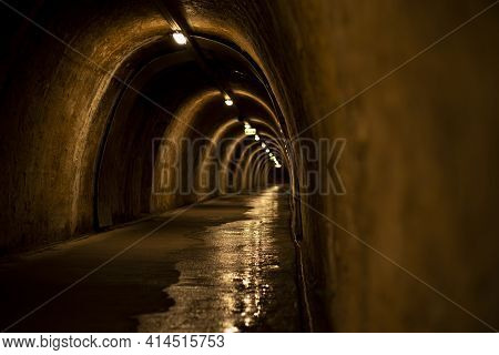 Underground Tunnel With Several Exits Illuminated By Light. Old Tunnel In The Capital Of Croatia In