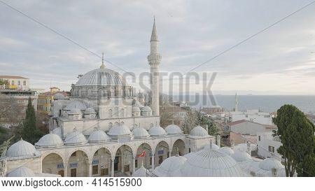 Beautiful White Mosque On Background Of Cloudy Sky. Action. Grand Mosque With Great History Attracts