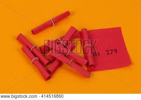 Red Tombola Tickets Lying On A Yellow Ground
