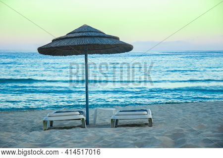 Beautiful Chaise Lounges In Nature By The Sea