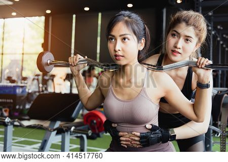 Portrait Of Attractive Young Sporty Asian Woman Is Work Out In Fitness Gym. Cross Fit Training. Musc