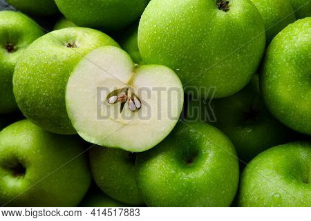 Close-up Green Apples Background, Half Apple On Whole Green Apples