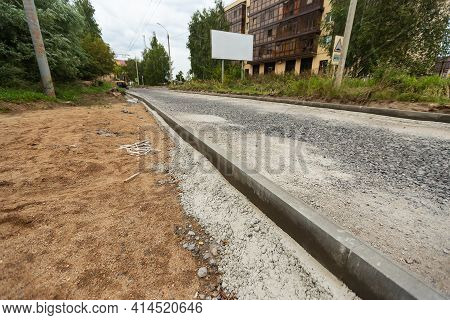 Construction Debris During Road Repairs. Updating The Curb Along The Roadway. Old Broken Curbs Are R
