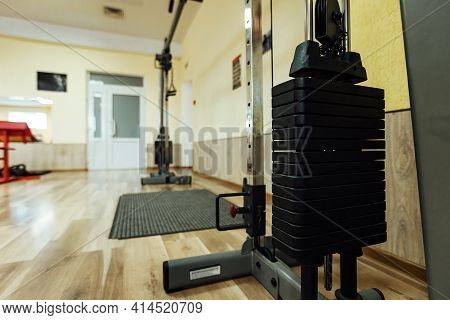 Heavy Dumbbells On The Counter. Sports Equipment In The Gym. Heavy Weight For Sports And A Healthy L