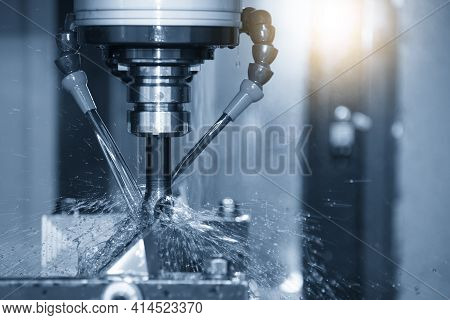 The Cnc Milling Machine Cutting The  Mold Parts With Oil Coolant Method. The Mold And Die Manufactur