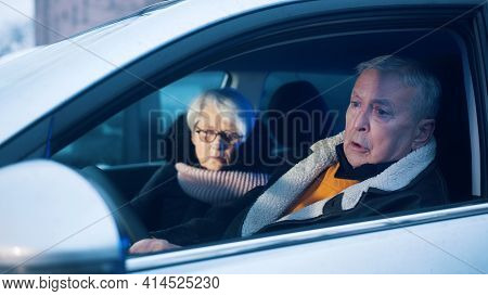 Elderly Couple In The Car Confused With Flashing Police Lights. Speeding Ticket. High Quality Photo