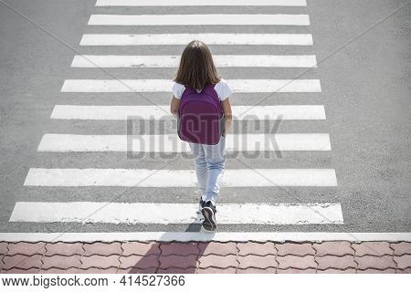 Stylish Young Teen Girl Walking With Backpack. Active Child. Kid Runs Across The Crosswalk. Way Forw