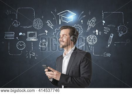 Businessman Wearing Suit Is Learning And Studying By Listening Podcast Using Smart Phone And Headpho