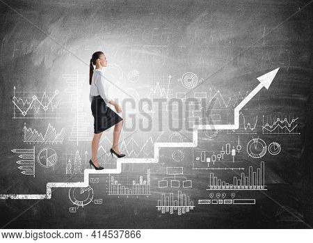 Woman Manager In Business Suit Climb Up The Stairs, Background Of Blackboard With Financial Analysis