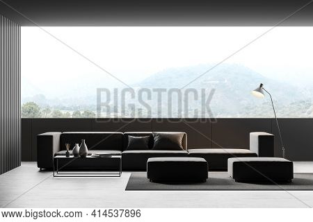 Modern Living Room Interior With Panoramic View On Picturesque Countryside, Black Comfortable Sofa,