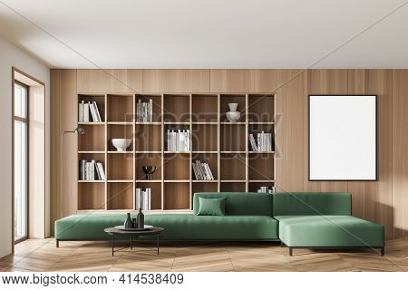 Modern Living Room Interior With Large Green Sofa, White Empty Poster On The Wooden Wall, Built-in B