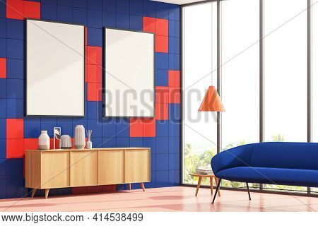 Bright Corner Living Room Interior With A Blue Cosy Sofa And Sideboard. Pink Wall Is Decorated With