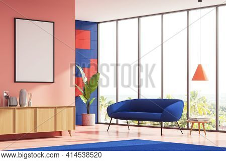 Bright Corner Living Room Interior With A Blue Cosy Couch, Coffee Table And Sideboard. Pink Wall Is
