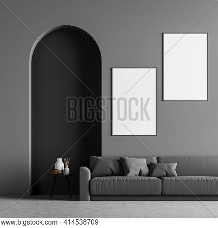 Living Room Interior With A Comfortable Sofa On Concrete Floor, Cosy Coffee Table And Two Posters Ne