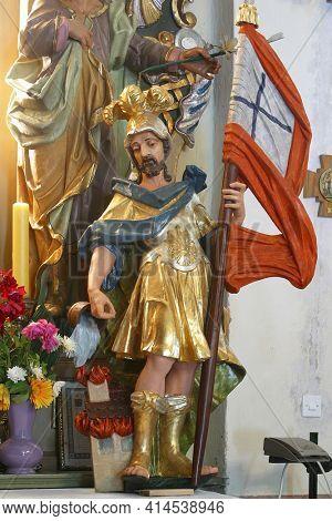 SVETI PETAR MREZNICKI, CROATIA - JULY 14, 2013: St. Florian, statue on the altar Our Lady of Sorrows in the parish church of St. Peter in Sveti Petar Mreznicki, Croatia