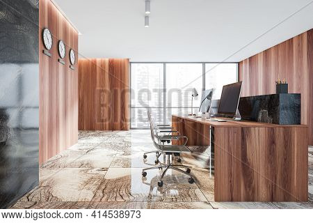 Wooden Reception Room Interior With Two Computers, Black Armchairs And Clocks. Reception Entrance Wi