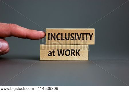 Inclusivity At Work Symbol. Wooden Blocks With Words 'inclusivity At Work' On Beautiful Grey Backgro