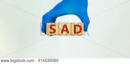Sad, Social Anxiety Disorder Symbol. Hand In Blue Glove Holds Wooden Cubes With Words Sad, Social An