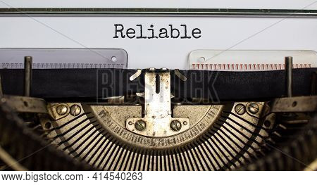 Reliable Symbol. The Word 'reliable' Typed On Retro Typewriter. Business, Reliable Concept. Beautifu