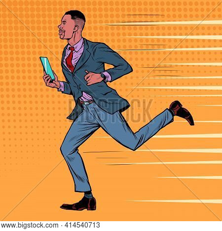 An African Businessman With A Smartphone Runs. Business People At Work