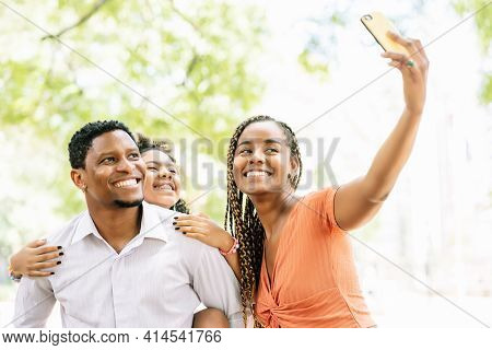 Family Taking A Selfie With A Mobile