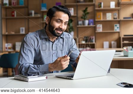 Young Bearded Indian Business Man Teacher Talking, Teleworking, Having Virtual Classroom Meeting Wor