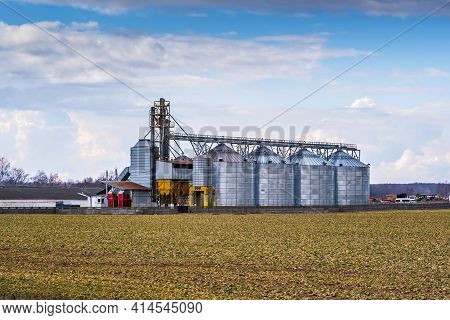 Granary Elevator. Silver Silos On Agro-processing And Manufacturing Plant For Processing Drying Clea