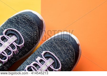 Pair Of Sport Running Shoes.shop Display Of Blue Sneakers Shoes Isolated On Bright Orange Background