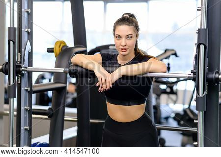 Beautiful Athletic Woman In The Sportswear Doing A Fitness Workout In The Gym. Athlete Enjoys Her Tr