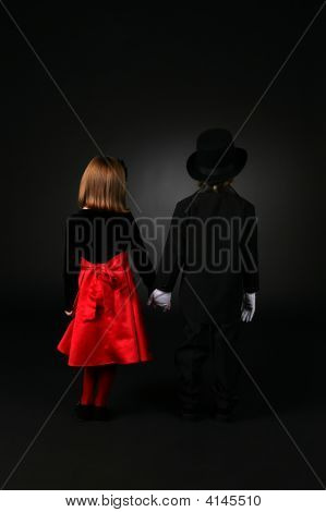 Back View Of Boy And Girl In Formal Clothing