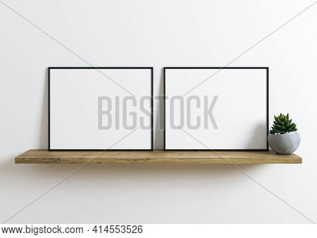 Double Black Horizontal Frame Mockup On Wooden Shelf With Green Plant And White Wall Behind It. Empt