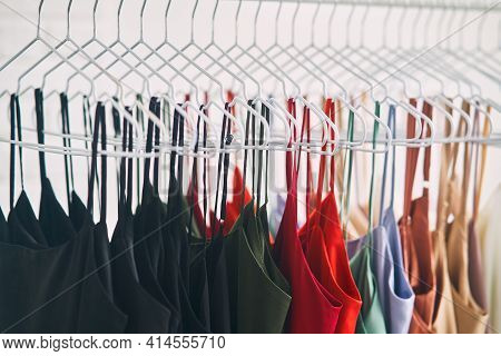 Multi-colored Dresses Hang On Hangers In The Store. Sale Of Womens Dresses