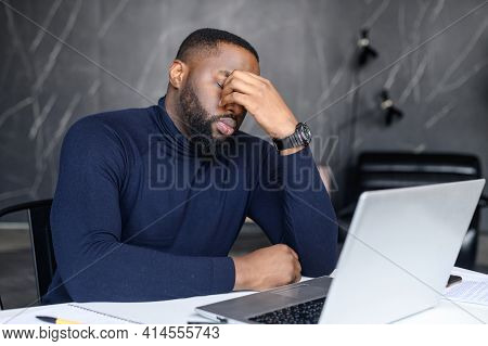 Difficult Task From Customer. African American Man Conducts Correspondence Using A Laptop, Hearing B