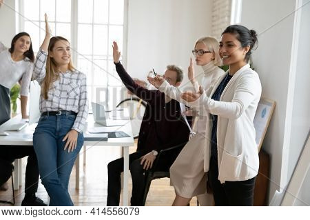 Smiling Diverse Employees Engaged In Teambuilding Activity