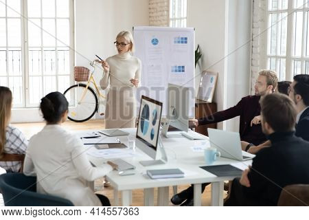 Confident Female Coach Lead Meeting In Office