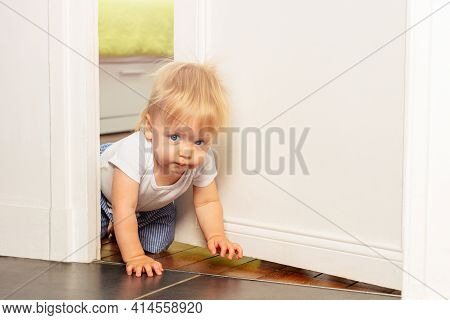 Toddler Crawl Out Of The Room With Serious Face