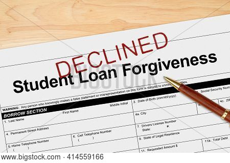 Student Loan Forgiveness Application Declined With Pen On A Wood Desk